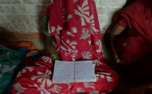 An Indian mother of one of two victims of gang-rape holds a schoolbook that belonged to her daughter at her house in Katrashadatganj in Badaun district of Uttar Pradesh state on June 1, 2014. Chandan Khanna/AFP/Getty Images