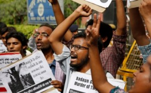 Members of Jawaharlal Nehru University Students Union shout slogans as they participate in a protest against the gang rape of two teenage girls in Katra village, outside the Uttar Pradesh state house, in New Delhi, India, Friday, May 30, 2014. AP Photo/Manish Swarup