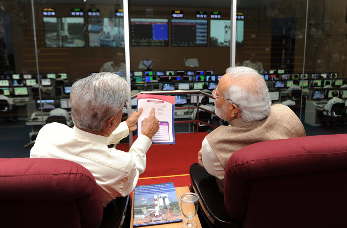In this photograph released by the Press Information Bureau (PIB) on June 30, 2014, Indian former ISRO scientist B.N Suresh (L) briefs Prime Minister Narendra Modi during the successful launch of a Polar Satellite Launch Vehicle (PSLV) at the programme's mission control in Sriharikota. (AFP/PIB)