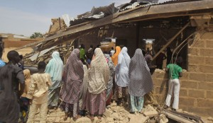 It is the latest bombing in a string of attacks blamed on Islamic extremist group Boko Haram that's killed some 200 people in the past week. Nearly 100 men and boys praying in a mosque were gunned down on Wednesday. On Friday, the military said six women suicide bombers caused explosions that killed scores of people including a soldier at Zabamari Muna village outside Maiduguri, the biggest city in northeast Nigeria and the birthplace of Boko Haram. Police Sunday rushed to the Redeemed Christian Church of God in Potiskum, the largest city in northeastern Yobe state. Wailing women and stunned men wandered around the wreckage of smashed bricks and twisted zinc sheets blown off the church roof. One congregant said the blast came from a woman in the congregation. She was too scared to give her name. An Associated Press reporter counted five bodies from the blast in the morgue of the local hospital, where a wounded woman was being treated. Nigeria's President Muhammadu Buhari on Friday condemned the latest attacks as barbaric and said they underline the need for an expanded multinational army to crush the extremists. Boko Haram took control of a large swath of northeast Nigeria last year and declared an Islamic caliphate. As it stepped up cross-border attacks, Nigeria and its neighbors deployed a multinational army that this year drove them out. But attacks are increasing as Boko Haram apparently responds to an Islamic State group directive to intensify violence during the Muslim holy month of Ramadan. At least 13,000 people have died in the 6-year-old Islamic uprising that has driven 1.5 million people from their homes.