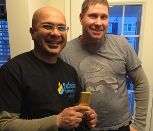 Alif Babul (left) and Dean Materi returned the brick to the original owners, as per Perfection Plumbing & Gas Ltd.'s company policy. (Supplied)